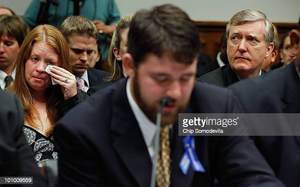 Sara Stone wipes away tears as she listens to her husband Transocean employee and survivor of Deepwater Horizon explosion Stephen Stone testify...