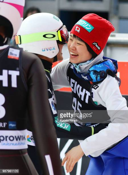 Sara Takanashi and Yuki Ito of Japan embrace after Takanashi's second jump at the women's ski jumping World Cup in Oberstdorf Germany on March 25...