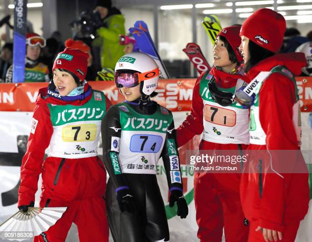 Sara Takanashi is congratulated by Yuka Seto Yuki Ito and Kaori Iwabuchi of Japan after competing in the Ladies' Team HS102 during day three of the...