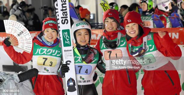 Sara Takanashi is congratulated by Yuka Seto Yuki Ito and Kaori Iwabuchi of Japan after competing in the Ladies' Team HS102 during day three of the...
