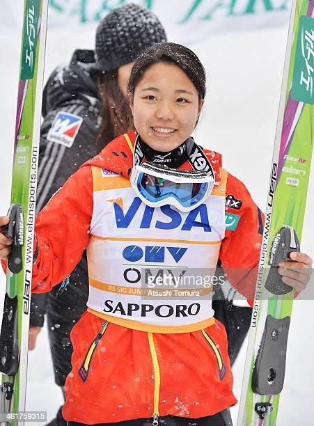 Sara Takanashi of Japan celebrates winning the FIS Women's Ski Jumping World Cup Sapporo at Miyanomori Ski Jump Stadium on January 11, 2014 in...