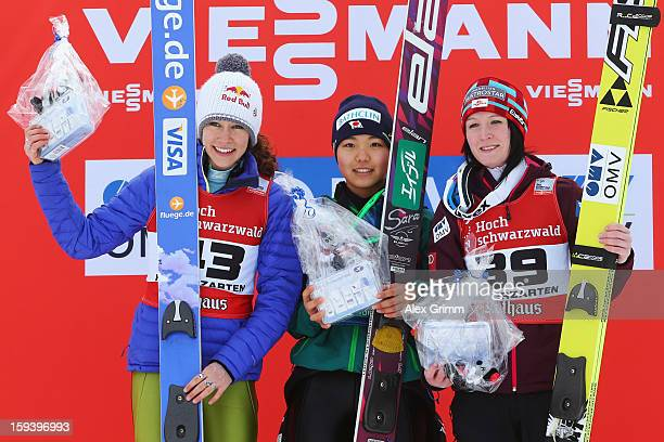 Sara Takanashi of Japan celebrtaes with second placed Sarah Hendrickson of the USA and third placed Jacqueline Seifriedsberger of Austria after...