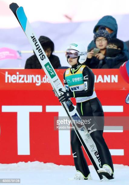 Sara Takanashi of Japan looks at the results' board after her first jump at a World Cup event in Pyeongchang South Korea on Feb 16 2017 Takanashi...