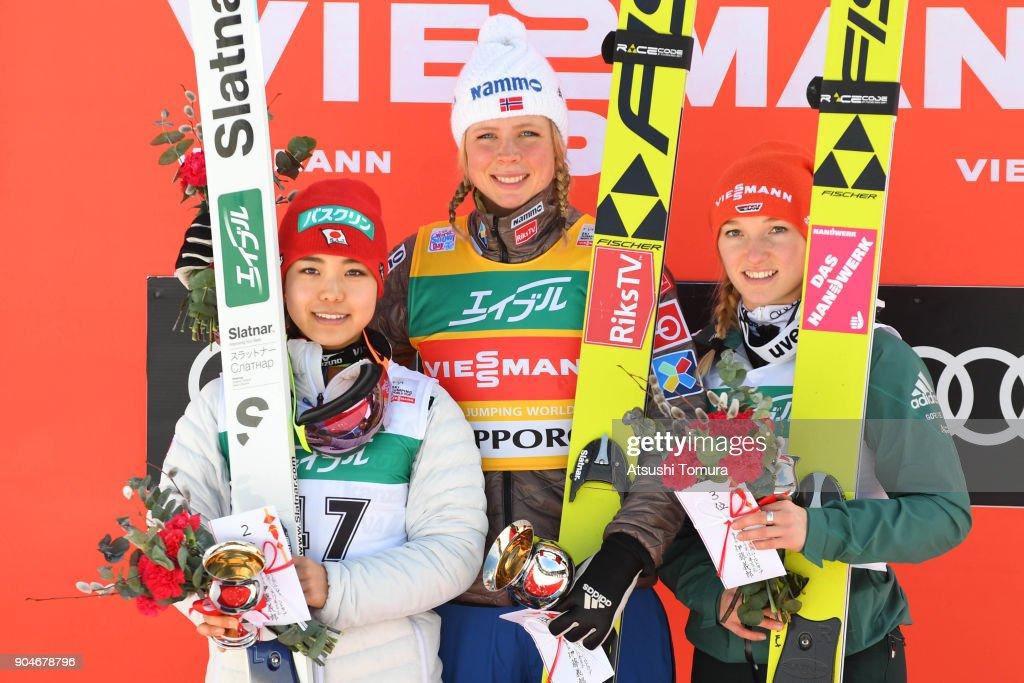 Sara Takanashi of Japan (silver), Maren Lundby of Norway (gold) and Katharina Althaus of Germany (bronze) pose on the podium during day two of the FIS Ski Jumping Women's World cup at Miyanomori Ski Jump Stadium on January 14, 2018 in Sapporo, Hokkaido, Japan.