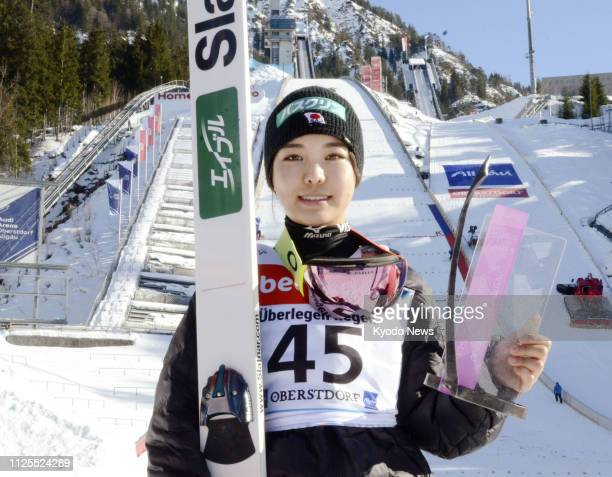 Sara Takanashi of Japan poses for photos after finishing third at a ski jumping World Cup event in Oberstdorf Germany on Feb 17 2019 ==Kyodo
