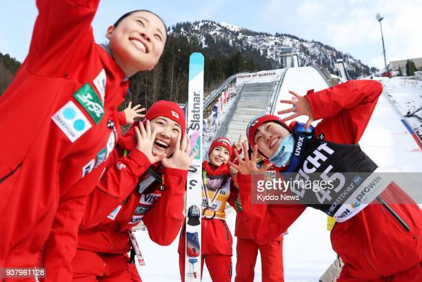 Sara Takanashi of Japan poses with Yuki Ito and teammates after winning her record 55th career ski jumping World Cup event in Oberstdorf Germany on...