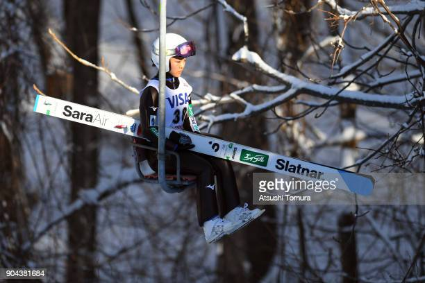 Sara Takanashi of Japan sits on the chairlift in the Ladies normal hill individual during day one of the FIS Ski Jumping Women's World cup at...