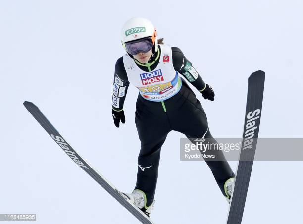 Sara Takanashi of Japan soars through the air during her first attempt at the normal hill mixed team event of the Nordic world ski championships in...