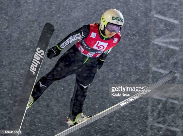 Sara Takanashi of Japan soars through the air during the qualification round of a women's World Cup ski jumping event in Trondheim Norway on March 13...