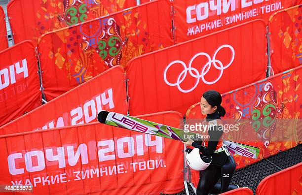 Sara Takanashi of Japan walks away after talking to the media during the Ladies' Normal Hill Individual Ski Jumping training on day 2 of the Sochi...