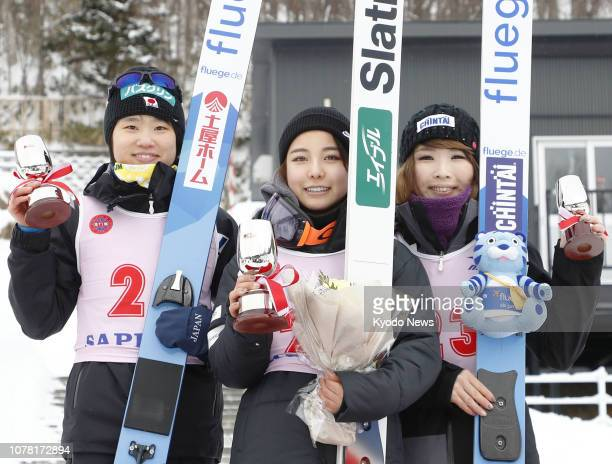 Sara Takanashi poses for photos after winning the women's title at the Sapporo Olympic Memorial ski jumping event at Miyanomori stadium in Sapporo...