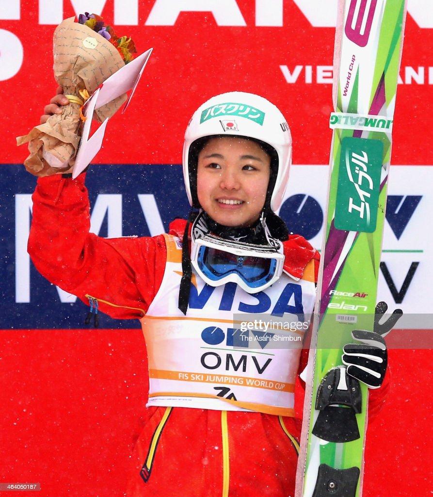 Sara Takanashi waves on the podium after winning at FIS Women's Ski Jumping World Cup Zao at Zao Jump Stadium on January 19, 2014 in Zao, Japan.