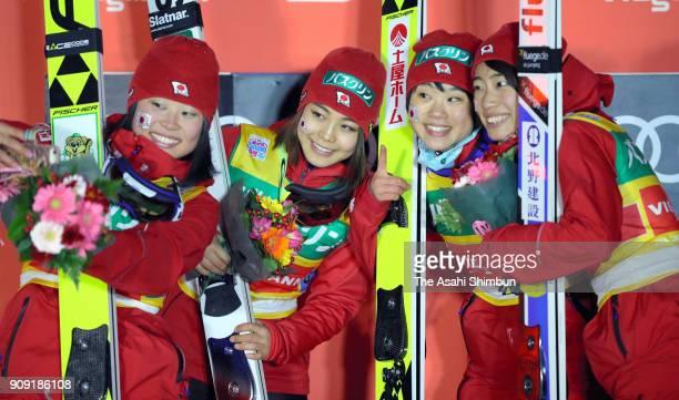 Sara Takanashi Yuka Seto Yuki Ito and Kaori Iwabuchi of Japan celebrate on the podium after winning the Ladies' Team HS102 during day three of the...