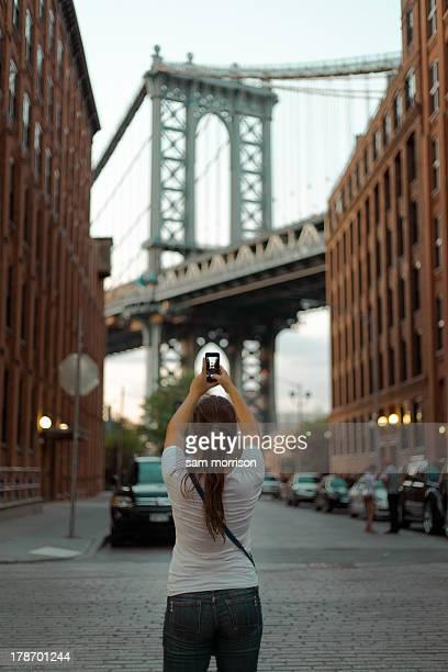 Sara taking a photo of the Manhattan Bridge