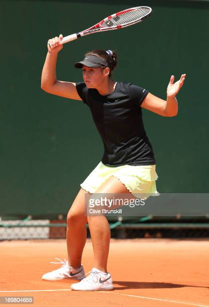 Sara Tomic of Australia plays a forehand in her girls' singles match against Jana Fett of Croatia during day eight of the French Open at Roland...