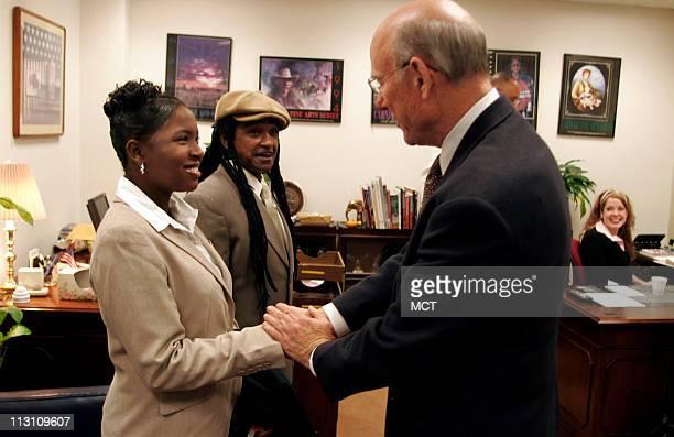 Sara TuckerCulver of Kansas City Kansas left and her father Louie Culver Jr meet with US Senator Pat Roberts at his office October 26 in Washington...