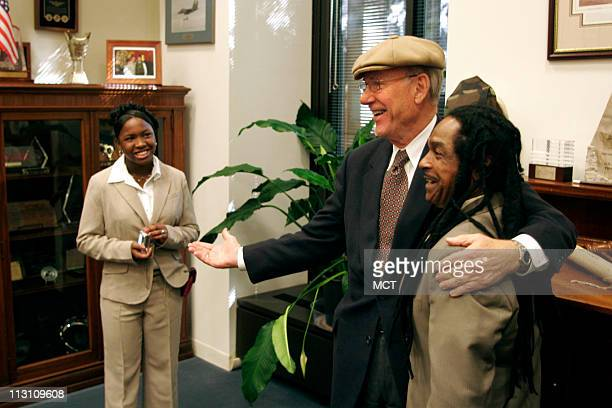 Sara TuckerCulver of Kansas City Kansas looks on as US Senator Pat Roberts tries on her father Louie Culver Jr's hat at his office October 26 in...