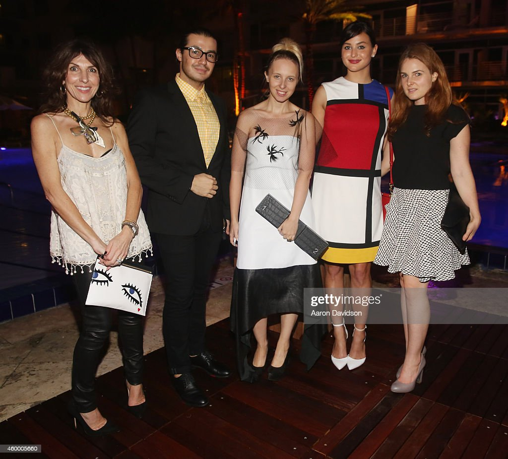 Sara Von Kienegger poses with guests at Sara Von Kienegger and Art of Elysium Host Los Angeles Gallery MAMA's Presentation Of Ryan Heffington's 'Wading Games' With Osk And Music BANKS at Ritz Carlton South Beach on December 4, 2014 in Miami Beach, Florida.