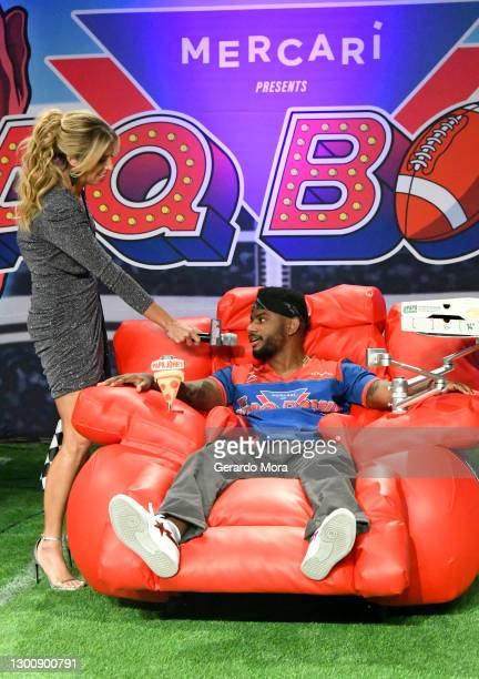 Sara Walsh and Bryson Tiller speak during The SHAQ Bowl for Super Bowl LV on February 07, 2021 in Tampa, Florida.