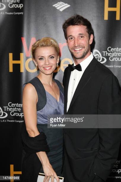Sara Wells and actor Noah Wyle pose during the arrivals for the opening night performance of 'War Horse' at Center Theatre Group/Ahmanson Theatre on...