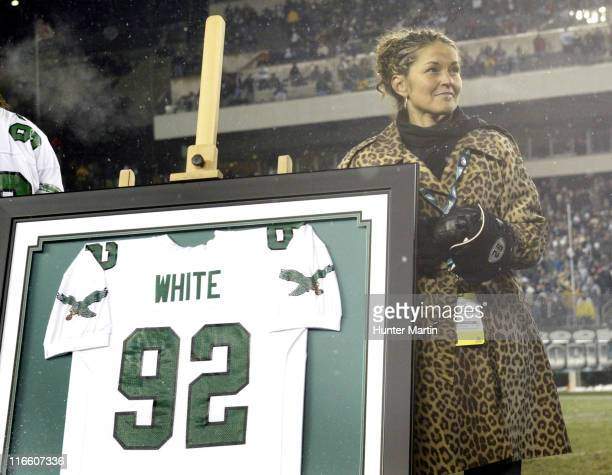 Sara White looks at video footage of her late husband Reggie White during halftime ceremonies retiring White's at Lincoln Financial Field Seattle...