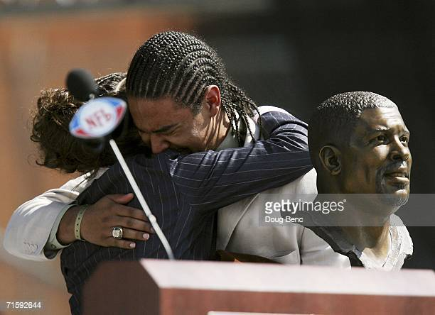 Sara White wife of the late defensive end Reggie White and his son Jeremy White react after the unveiling of Reggie White's bust during the Class of...