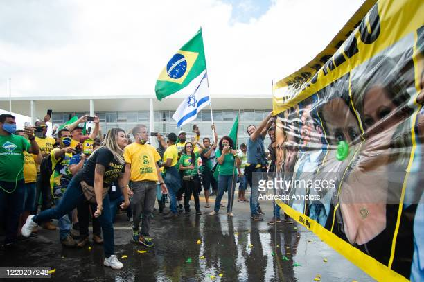 "Sara Winter, the leader of the extreme right group ""300 do Brasil"" and supporter of Brazilian President Jair Bolsonaro, throw water balloons at a..."