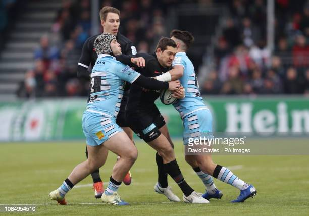 Saracens Alex Goode is tackled by Glasgow's Grant Stewart and Adam Hastings during the Heineken European Challenge Cup pool three match at Allianz...