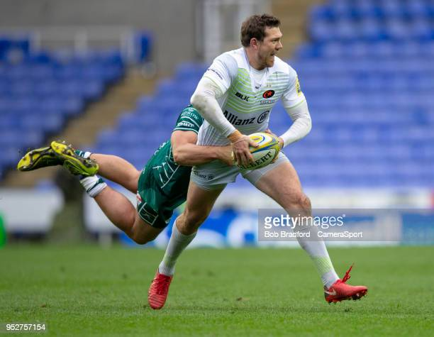 Saracens' Alex Goode is tackled by London Irish's Tom Fowlie during the Aviva Premiership match between London Irish and Saracens at Madejski Stadium...