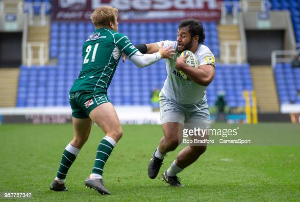 Saracens' Billy Vunipola evades the tackle of London Irish's Scott Steele during the Aviva Premiership match between London Irish and Saracens at...