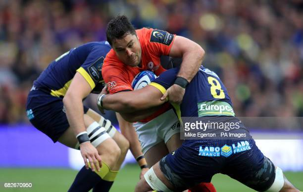 Saracen's Brad Barritt is tackled by Clermont Auvergne's Arthur Iturria and Fritz Lee during the European Champions Cup Final at BT Murrayfield...