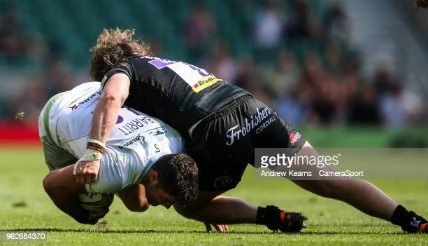 Saracens' Brad Barritt is tackled by Exeter Chiefs' Alec Hepburn during the Aviva Premiership Final between Exeter Chiefs and Saracens at Twickenham...