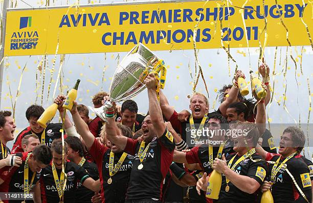 Saracens captain Steve Borthwick lifts the trophy after the AVIVA Premiership Final between Leicester Tigers and Saracens at Twickenham Stadium on...