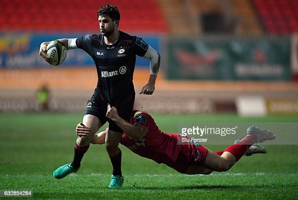 Saracens captain Tim Streather races past Scarlets wing Corey Baldwin during the Anglo-Welsh Cup match at Parc y Scarlets on January 27, 2017 in...