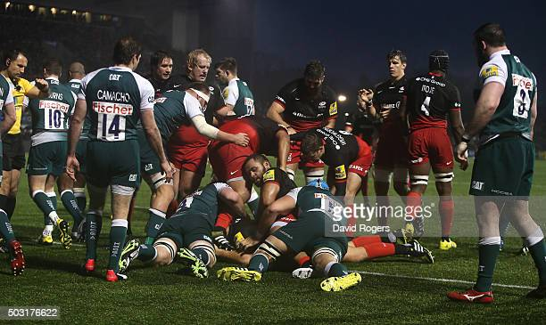 Saracens celebrate after Jamie George scores a try during the Aviva Premiership match between Saracens and Leicester Tigers at Allianz Park on...