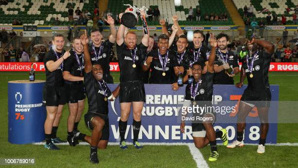 Saracens celebrate after their victory in the cup final against Wasps during day two of the Premiership Rugby 7's at Franklin's Gardens on July 28,...