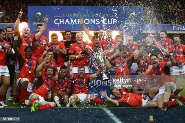 Saracens celebrate with the trophy following their 28-17 victory during the European Rugby Champions Cup Final between ASM Clermont Auvergne and...