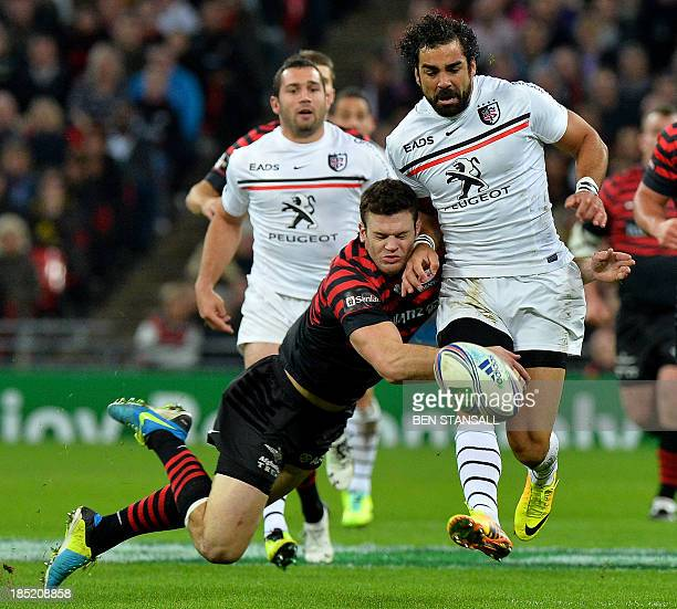 Saracens' centre Duncan Taylor vies with Toulouse wing Yoann Huget during the European cup rugby union match between Saracens and Toulouse at Wembley...