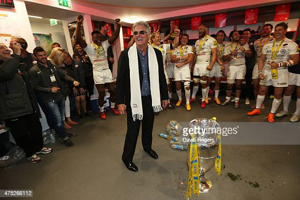 Saracens Chairman Nigel Wray congratulates the players following their 2816 victory during the Aviva Premiership Final between Bath Rugby and...