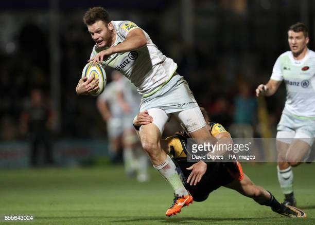 Saracens Duncan Taylor is tackled by Worcester Warriors Josh Adams during the Aviva Premiership match at Sixways Stadium, Worcester.