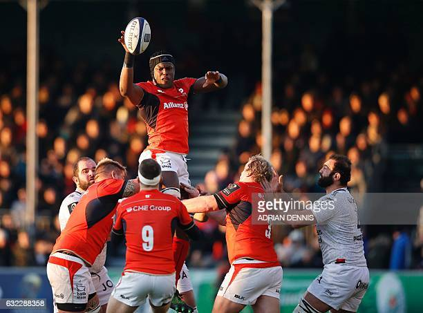 Saracens' English lock Maro Itoje wins the ball in the line-out during the European Rugby Champions Cup, pool 3 rugby union match between Saracens...