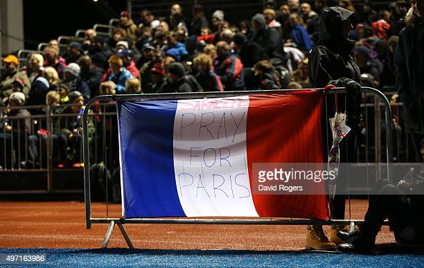 Saracens fan places a French flag to show the Saracens support and respect for the victims of the attrocities carried out in Paris during the...