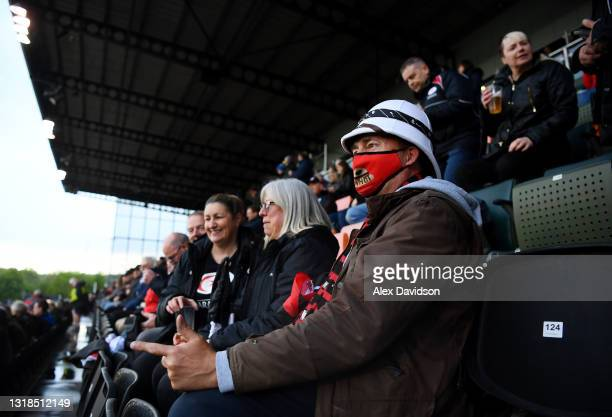 Saracens fans watch on during the Greene King IPA Championship match between Saracens and Ampthill at the StoneEX Stadium on May 17, 2021 in Barnet,...