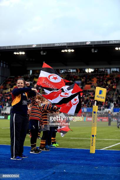 Saracens flag bearers welcome players onto the pitch during the Aviva Premiership match between Saracens and Worcester Warriors at Allianz Park on...