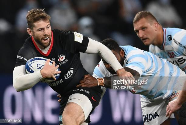 Saracens' full back Elliot Daly vies with Racing's French centre Virimi Vakatawa during the European Rugby Champions Cup semi-final rugby union match...