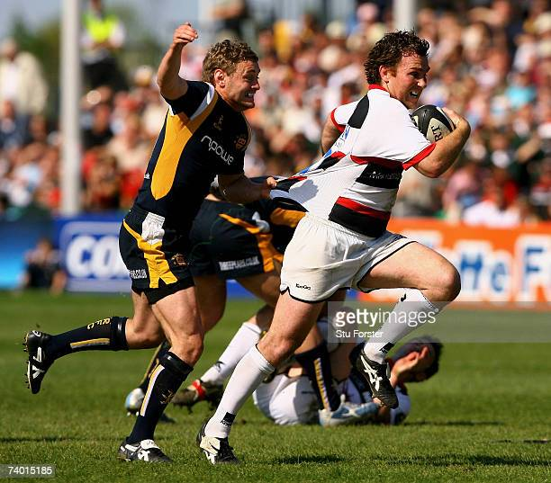 Saracens half back Glen Jackson is tackled by James Brown of Worcester during the Guinness Premiership match between Worcester Warriors and Saracens...