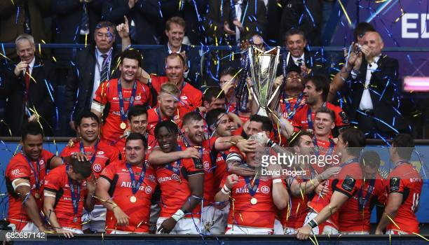 Saracens lift the trophy following their 28-17 victory during the European Rugby Champions Cup Final between ASM Clermont Auvergne and Saracens at...