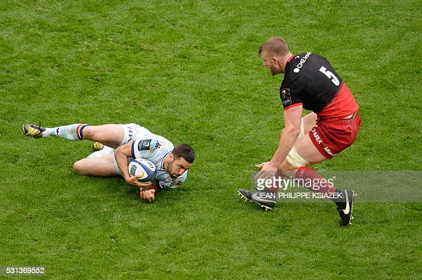 Saracens' lock George Kruis vies for the ball with Racing Metro's Luke Charteris during the European Rugby Champions Cup match beetween Racing Metro...
