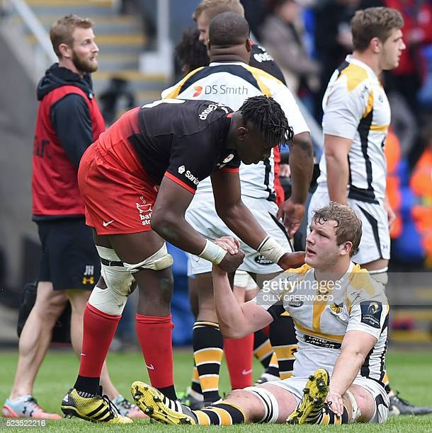 Saracens' lock Maro Itoje consoles fellow second row Wasps' lock Joe Launchbury after the European Rugby Champions Cup semifinal rugby union match...