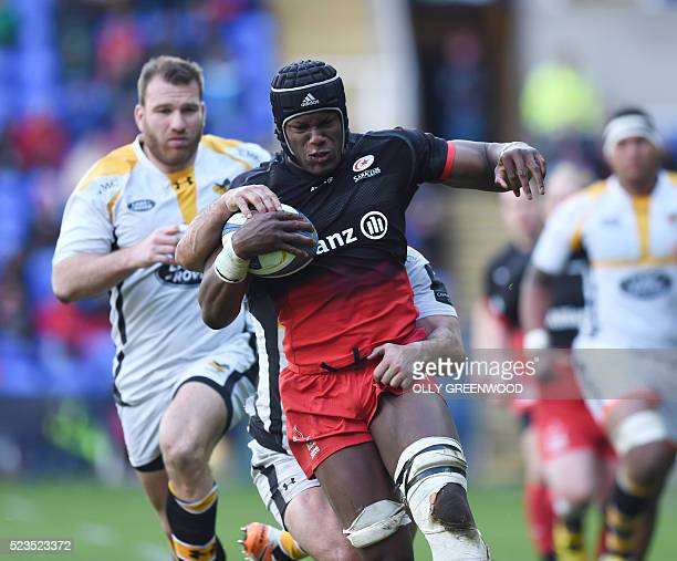 Saracens' lock Maro Itoje is tackled by Wasps' New Zealand full back Charles Piutau during the European Rugby Champions Cup semifinal rugby union...